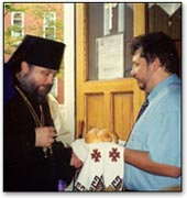 The church warden greets the Bishop.